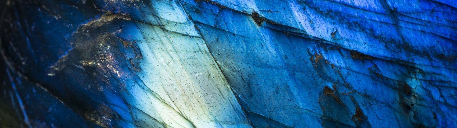 Close up view of polished cobalt with gradient blue colors throughout with lots of shine.